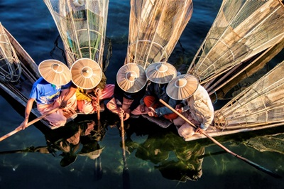 Fishermen on their longtail boats in Inle lake, Burma