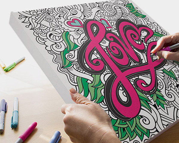 Love By Olga Kostenko coloring canvas on desk with bright and colorful markers