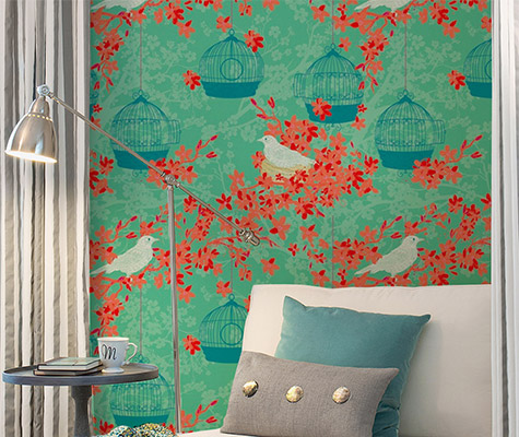 orange and aqua birdcage removable wallpaper next to lounge chair and floor lamp