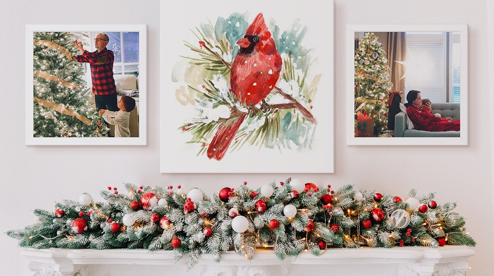 picture of a cardinal hanging over a fireplace mantle with two framed canvases