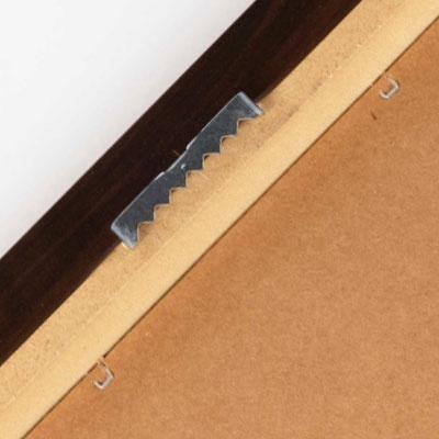 Back of framed print showing saw tooth hanger