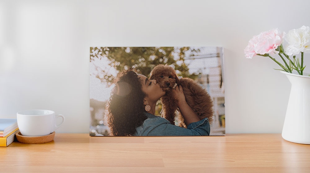 woman and puppy printed on a flat tabletop canvas print