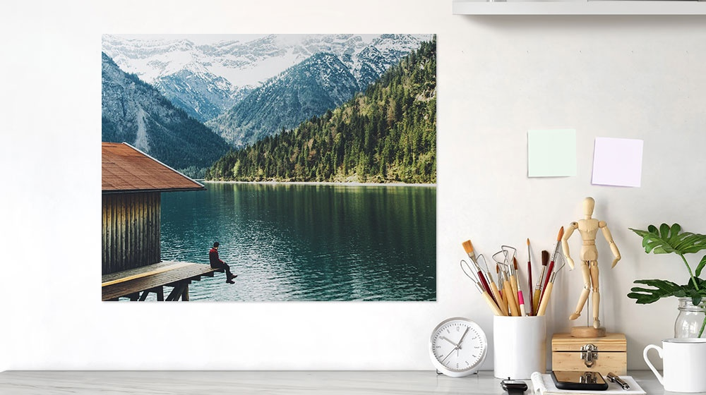 lake landscape printed on a poster and hanging at a desk