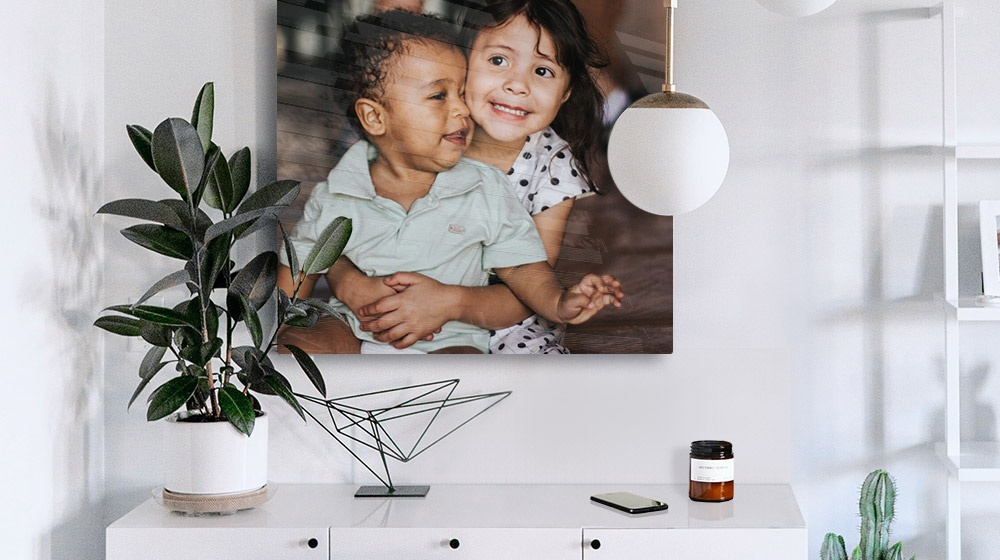 acrylic photo print of two kids in a minimalist modern room