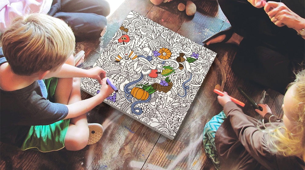 family sharing a coloring canvas