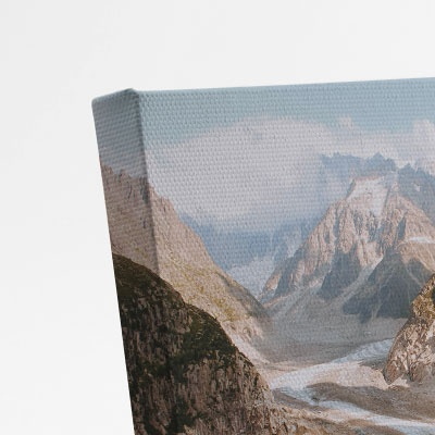 A close-up photo of a desktop canvas print showing thickness and quality