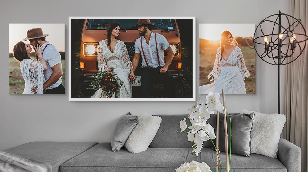 two 16x20 and one framed 36x24 canvas prints in an elegant living room
