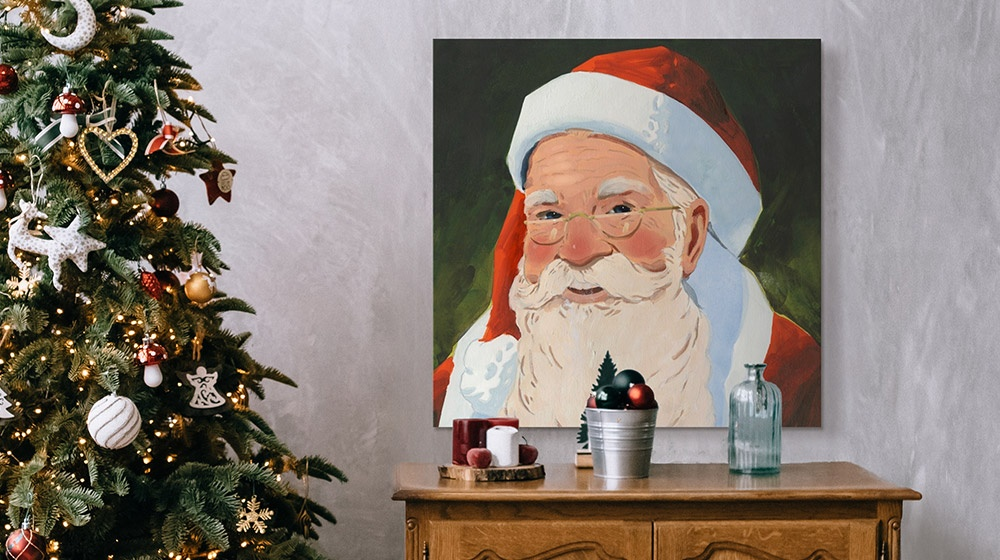 image of Santa Claus on wall next to Christmas tree and décor
