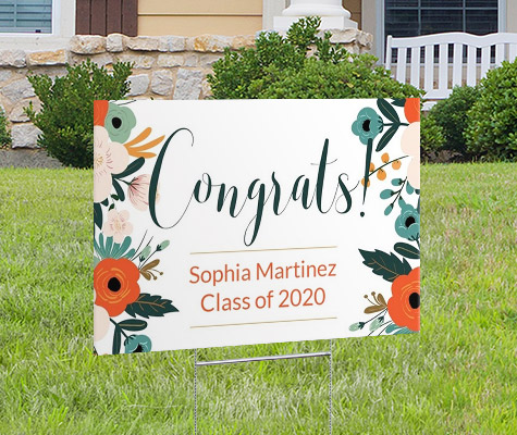 congrats script floral graduation yard sign in front yard of house