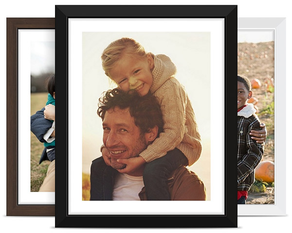 collection of photos on framed premium canvas prints with walnut, black, and white frames