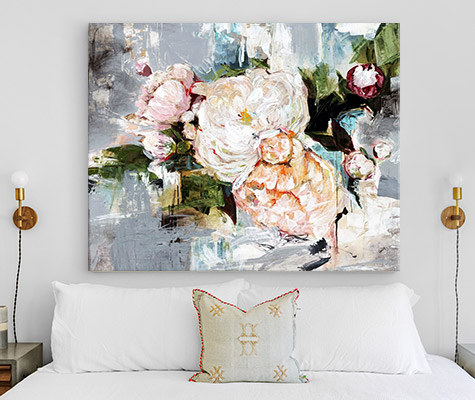 Peony Bloom by Alexys Henry hung on the wall above a bed with decorative pillow