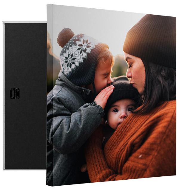 canvas print featuring a photo of a mom and two kids in cold weather